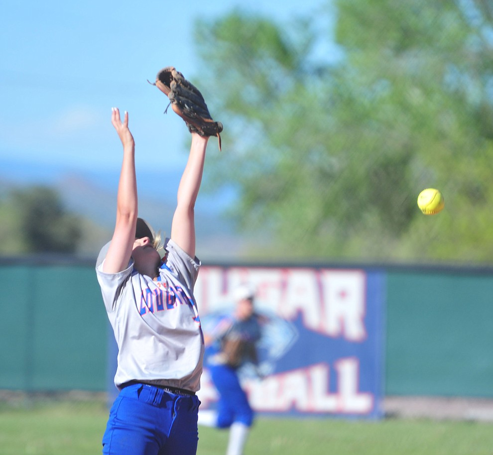 Chino Valley's Jacey Buchanan just misses the ball as the Cougars play Pusch Ridge in the play-in round of the Arizona Interscholastic Association State Softball D3 Tournament Wednesday, April 24 in Chino Valley.  (Les Stukenberg/Courier)