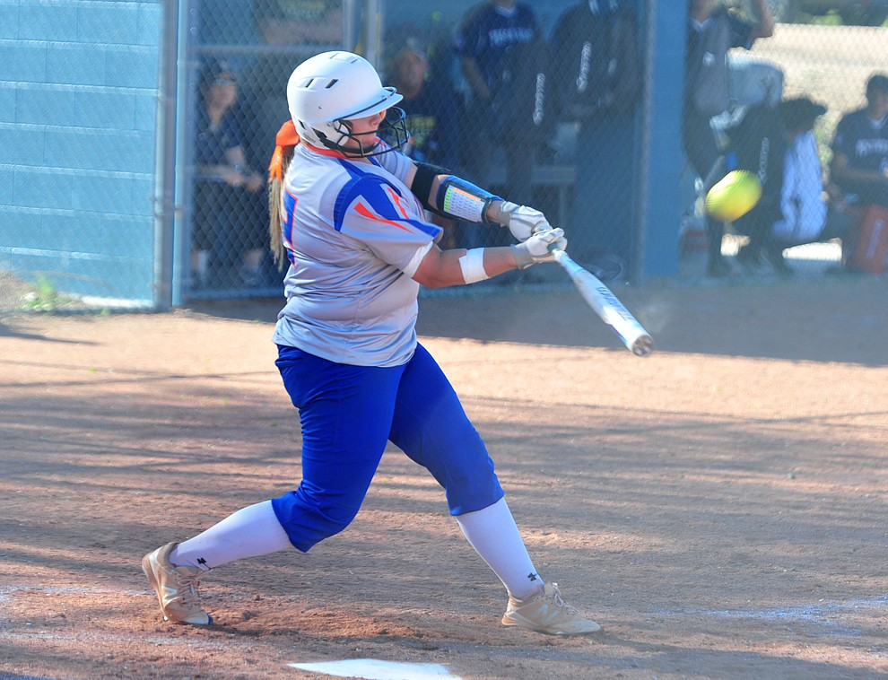 Chino Valley's Daviren Passmore hits a double as the Cougars play Pusch Ridge in the play-in round of the Arizona Interscholastic Association State Softball D3 Tournament Wednesday, April 24 in Chino Valley.  (Les Stukenberg/Courier)