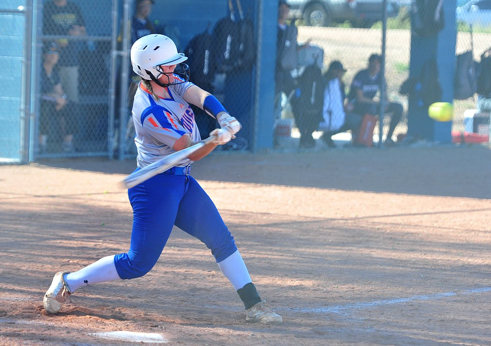 Chino Valley's Angelina Kirkpatrick hits a three-run homer as the Cougars play Pusch Ridge in the play-in round of the Arizona Interscholastic Association State Softball D3 Tournament Wednesday, April 24 in Chino Valley.  (Les Stukenberg/Courier)