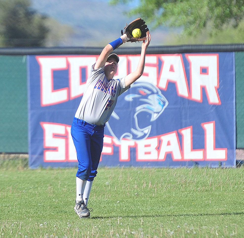 Chino Valley's Kacey Mathews makes the catch in center field as the Cougars play Pusch Ridge in the play-in round of the Arizona Interscholastic Association State Softball D3 Tournament Wednesday, April 24 in Chino Valley.  (Les Stukenberg/Courier)