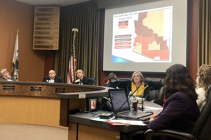 Members of the Prescott City Council listen to a report about the opioid crisis during a February meeting, prior to voting to pursue a lawsuit against pharmaceutical companies. The lawsuit is asking for damages for the harms the community has suffered from the opioid epidemic. (Cindy Barks/Courier, file)