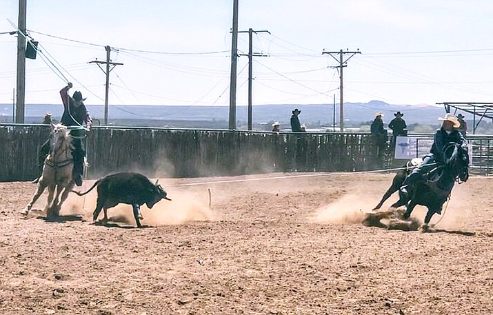 Navajo Technical University header Erik Becenti ropes his steer while Hiyo Yazzie of Mesalands Community College trails. The team finished with a time of 7.5 seconds at the NMSU rodeo on March 31. (Photo/Navajo Technical University