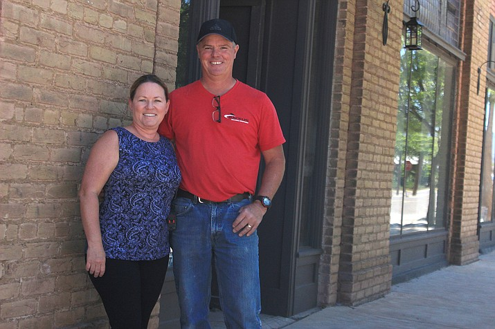 Becky and Craig Backus in front of the future Park Hotel on Main Street in Clarkdale. VVN/Kelcie Grega