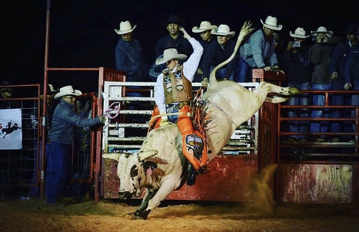 Paulden pro bull rider J.C. Mortensen, who will graduate from Chino Valley High School in May, is seen here riding a bull in Tuba City in 2018. Mortensen, 18, who only recently turned pro, has a bright future in the sport. (Becenti Photography/Courtesy)