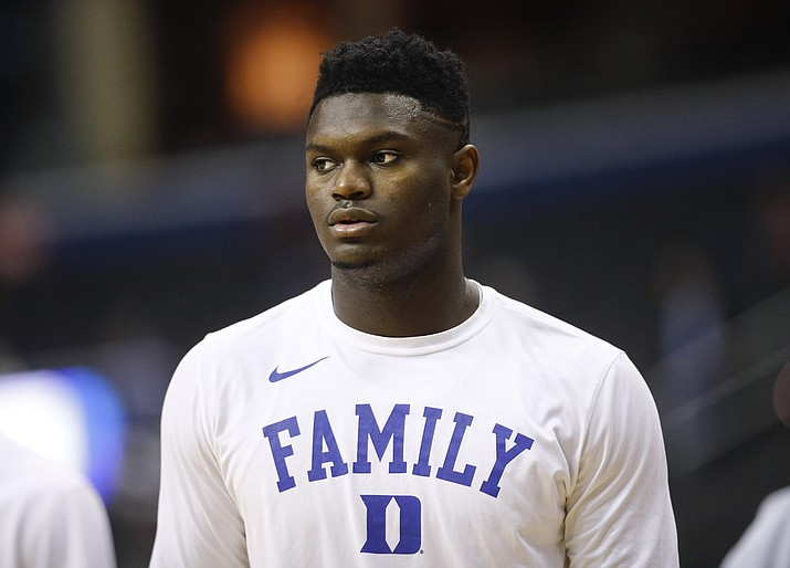 In this March 31, 2019, file photo, Duke forward Zion Williamson warms up before the start of an NCAA men's East Regional final college basketball game against Michigan State, in Washington. The player widely projected to be the NBA draft's top overall pick came up at a college basketball corruption trial as jurors heard a recording of a Clemson coach who seemed eager for help recruiting him. The charismatic Zion Williamson played one year at Duke before entering the draft scheduled for June. (Patrick Semansky/AP, file)