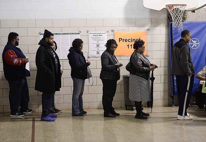 Voters wait in line on Election Day, Nov. 6, 2018, in Southfield, Mich. A three-judge panel has ruled that Michigan's congressional and legislative maps are unconstitutionally gerrymandered, ordering the state Legislature to redraw at least 34 districts for the 2020 election. (Clarence Tabb, Jr /Detroit News via AP, File)