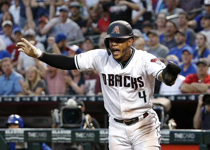 Arizona Diamondbacks' Ketel Marte reacts after being called safe on a play at the plate while scoring on an RBI-double by teammate Adam Jones during the first inning against the Chicago Cubs, Friday, April 26, 2019, in Phoenix. (Ralph Freso/AP)