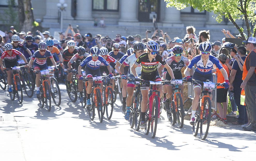 Kate Courtney and Catharine Pendrel lead the field off the first turn during the Whiskey Off Road Fat Tire Crit through the streets of downtown Prescott Friday, April 26.  (Les Stukenberg/Courier)