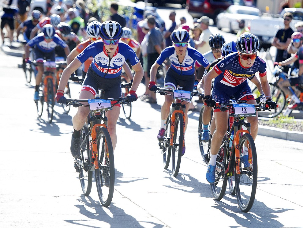 Haley Batten and Erin Huck lead the chase group up Union Street during the Whiskey Off Road Fat Tire Crit through the streets of downtown Prescott Friday, April 26.  (Les Stukenberg/Courier)