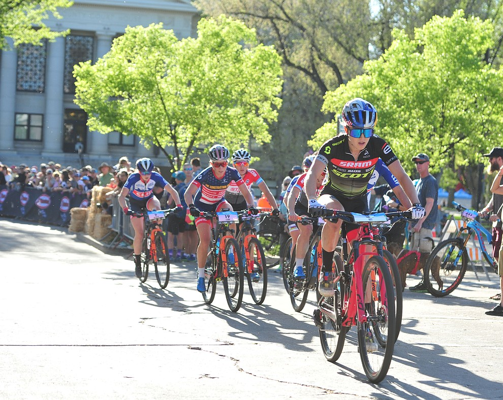 Kate Courtney leads during the Whiskey Off Road Fat Tire Crit through the streets of downtown Prescott Friday, April 26.  (Les Stukenberg/Courier)