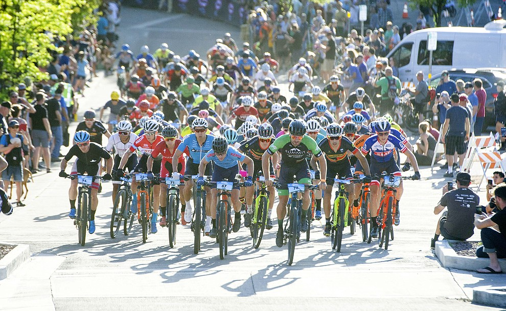 The men head up Union Street during the Whiskey Off Road Fat Tire Crit through the streets of downtown Prescott Friday, April 26.  (Les Stukenberg/Courier)