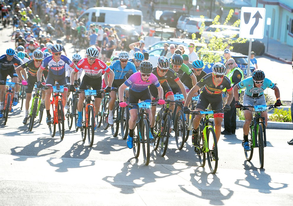 It was a battle especially early on during the Whiskey Off Road Fat Tire Crit through the streets of downtown Prescott Friday, April 26.  (Les Stukenberg/Courier)