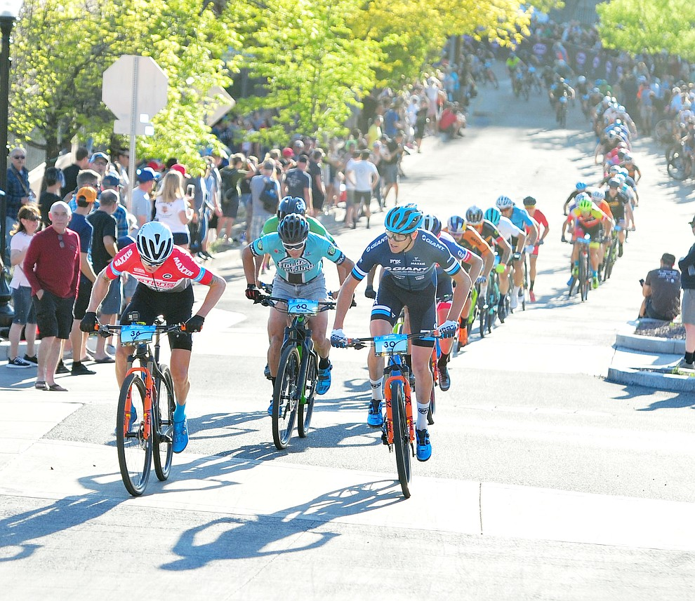 Keegan Swenson takes the lead from Stephan Davoust during the Whiskey Off Road Fat Tire Crit through the streets of downtown Prescott Friday, April 26.  (Les Stukenberg/Courier)