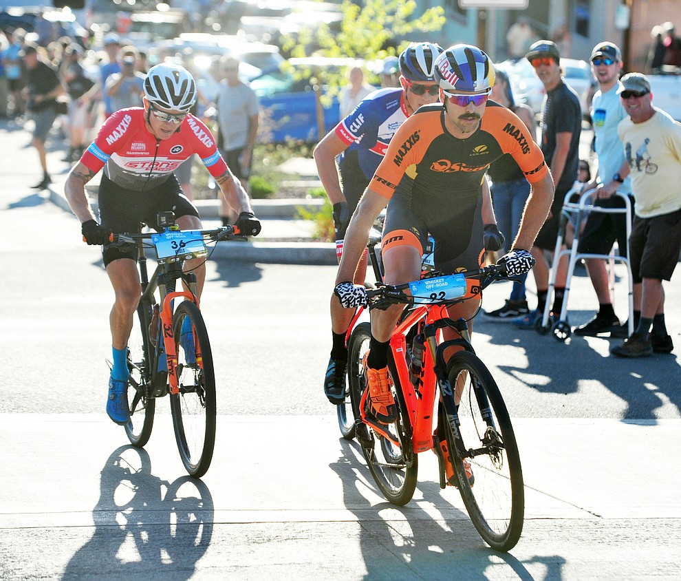 Payson McElveen takes the lead up Union Street during the Whiskey Off Road Fat Tire Crit through the streets of downtown Prescott Friday, April 26.  (Les Stukenberg/Courier)