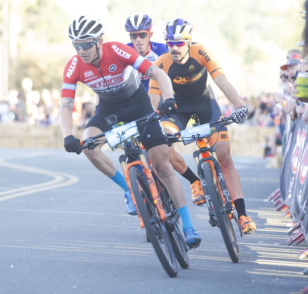 Keegan Swenson leads as they head up Union Street during the Whiskey Off Road Fat Tire Crit through the streets of downtown Prescott Friday, April 26.  (Les Stukenberg/Courier)