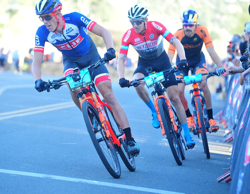 Russell Finsterwald leads as they head up Union Street during the Whiskey Off Road Fat Tire Crit through the streets of downtown Prescott Friday, April 26.  (Les Stukenberg/Courier)