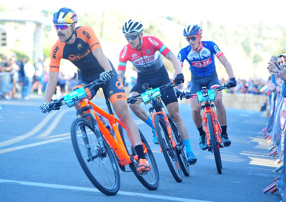 Payson McElveen leads the final lap onto Union Street during the Whiskey Off Road Fat Tire Crit through the streets of downtown Prescott Friday, April 26.  (Les Stukenberg/Courier)