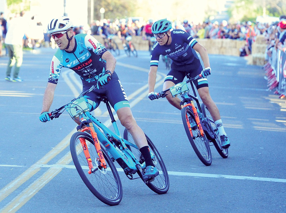Geoff Kabush and Stephan Davoust jockey for position during the Whiskey Off Road Fat Tire Crit through the streets of downtown Prescott Friday, April 26.  (Les Stukenberg/Courier)