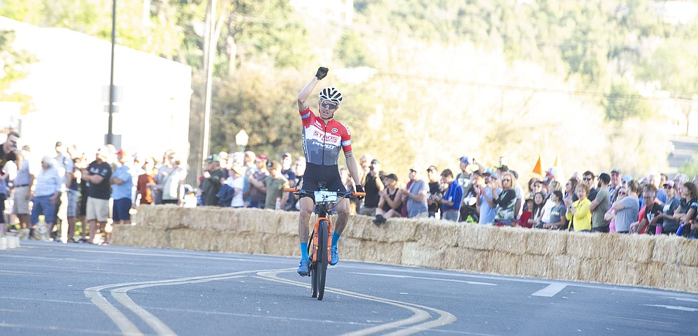Keegan Swenson wins the Whiskey Off Road Fat Tire Crit through the streets of downtown Prescott Friday, April 26.  (Les Stukenberg/Courier)