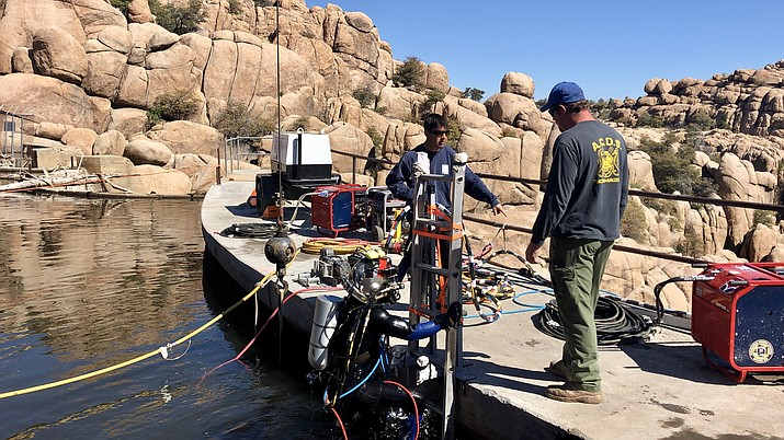 A diver with Tucson-based Arizona Commercial Diving Services comes to the surface after spending 60 minutes underwater at the Watson Lake dam.  (Cindy Barks/Courier)