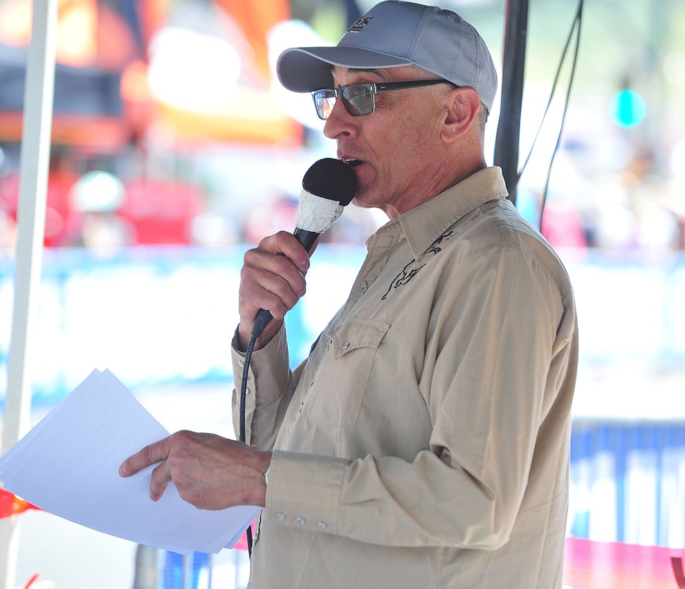 Announcer Larry Grossman on the microphone during the opening day of the Whiskey Off Road in downtown Prescott Friday, April 26.  (Les Stukenberg/Courier)