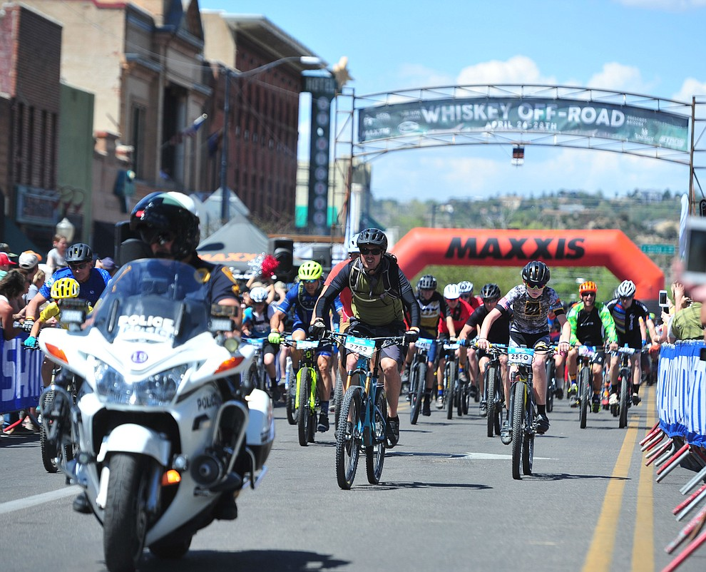 268 racers head out on the 15 mile course during the opening day of the Whiskey Off Road in downtown Prescott Friday, April 26.  (Les Stukenberg/Courier)