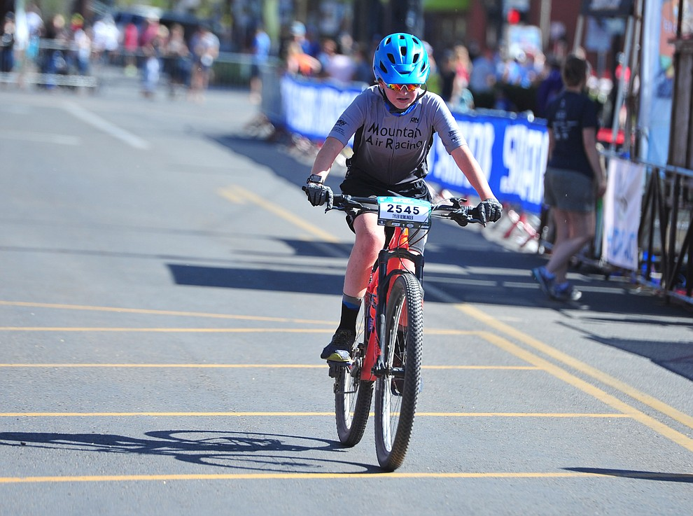 Tyler Remlinger crosses the finish line of the 15-mile race during the opening day of the Whiskey Off Road in downtown Prescott Friday, April 26.  (Les Stukenberg/Courier)