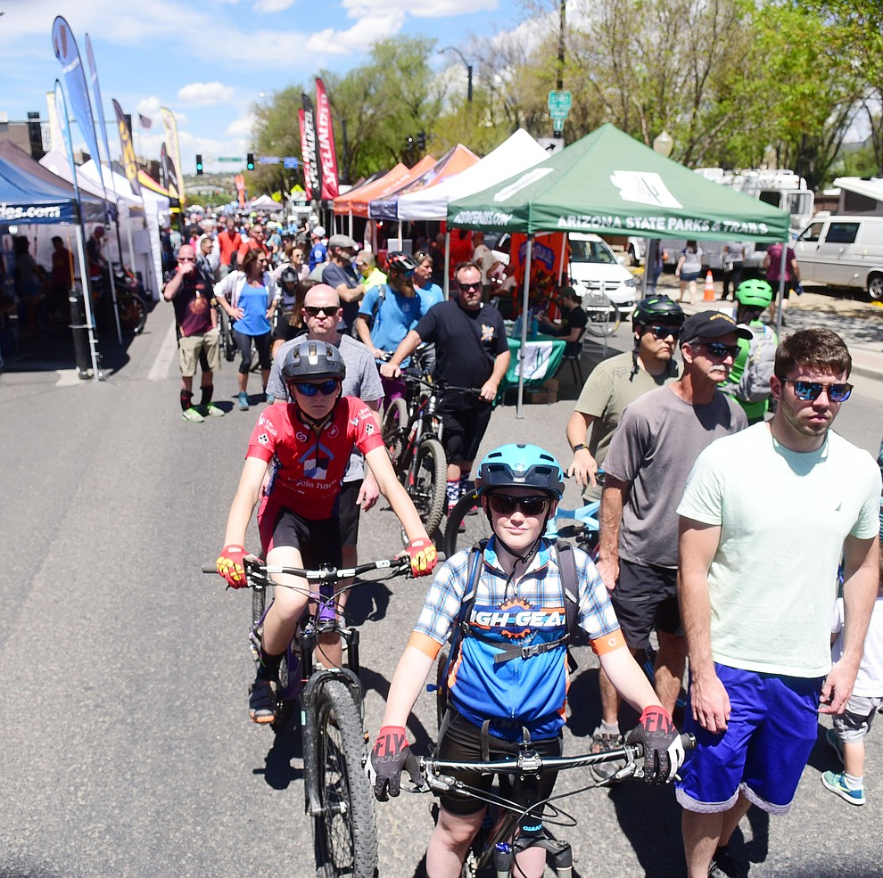 Racers wait in line to get their number plates during the opening day of the Whiskey Off Road in downtown Prescott Friday, April 26.  (Les Stukenberg/Courier)