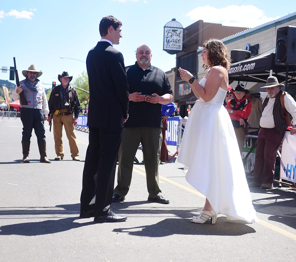 Greg and Bess Dougherty of Indinapolis, IN held their wedding ceremony on the start line on opening day of the Whiskey Off Road in downtown Prescott Friday, April 26.  (Les Stukenberg/Courier)