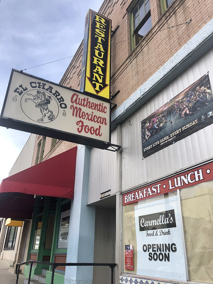 A sign in the window of the old El Charro Mexican restaurant on Montezuma Street tells of the pending opening of Carmella's, a new Italian-food breakfast, lunch, and dinner spot. The downtown-Prescott business got its liquor-license OK from the city last week, and is expected to open for business within about six weeks. (Cindy Barks/Courier)