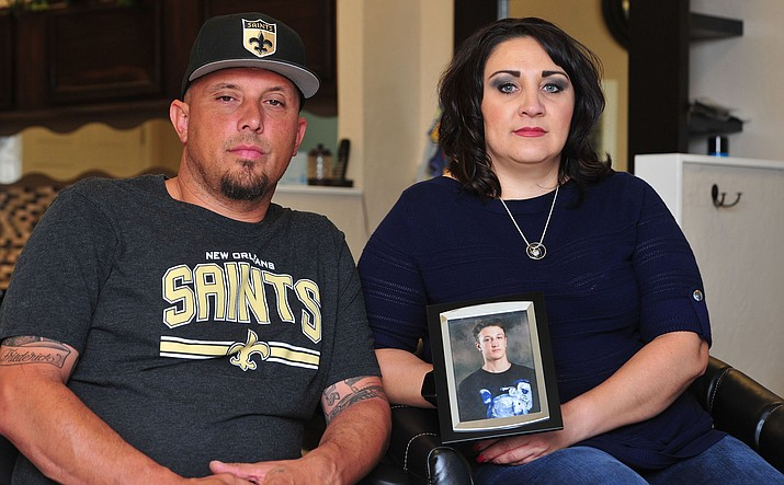 Joseph and Angela Friederick hold a photo of their son Jared, Wednesday, April 24 in Prescott Valley. He died from a fentanyl overdose in June 2018.  (Les Stukenberg/Courier)