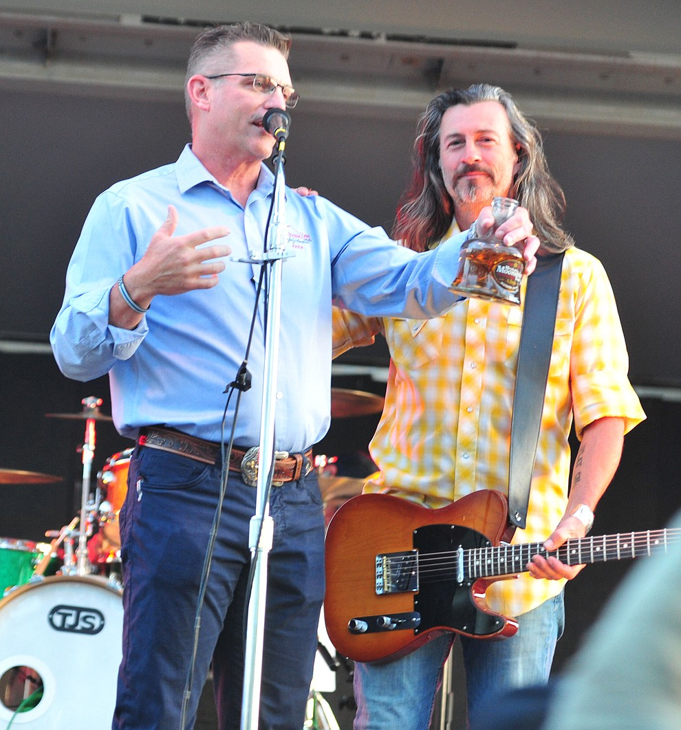 Prescott Mayor Greg Mengarelli takes a sip of Mexican Moonshine with Roger Clyne and the Peacemakers at the Whiskey Off Road in Prescott Saturday, April 27.  (Les Stukenberg/Courier)