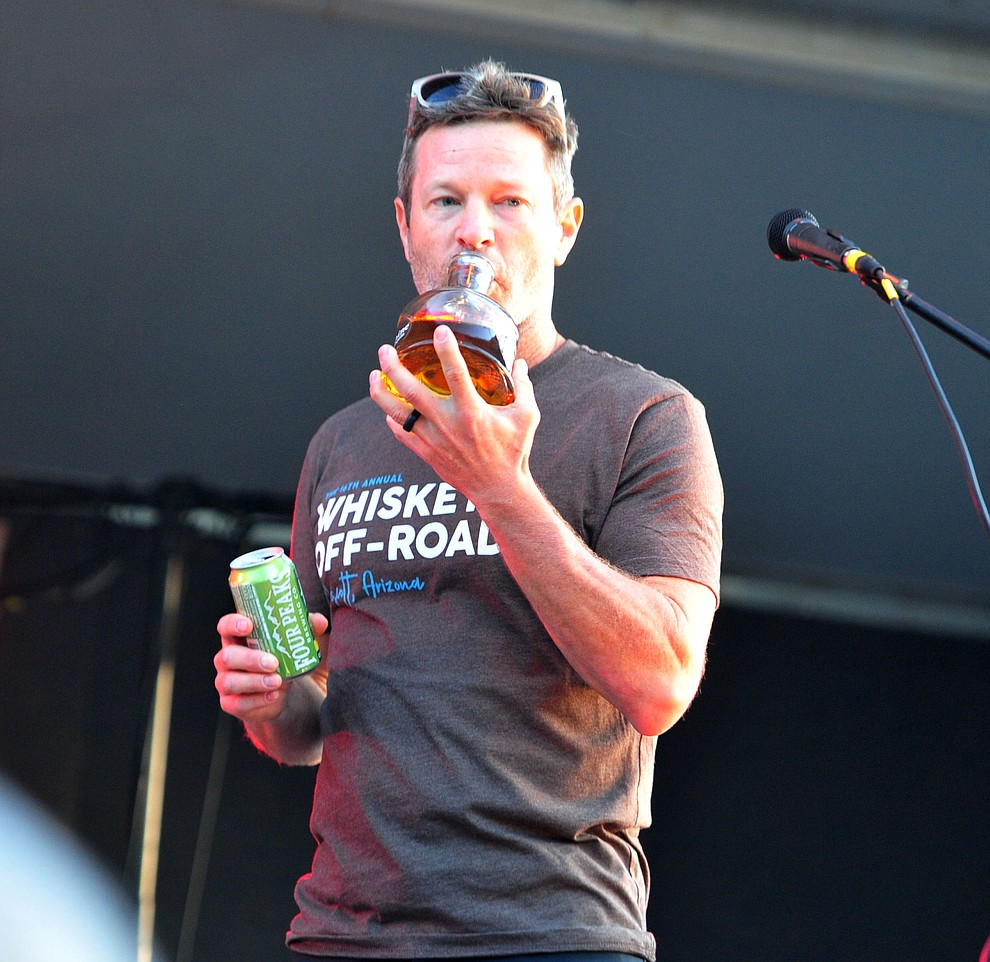 Todd Sadow takes a sip of Mexican Moonshine with Roger Clyne and the Peacemakers at the Whiskey Off Road in Prescott Saturday, April 27.  (Les Stukenberg/Courier)
