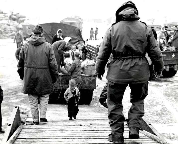"A Korean toddler climbs the boarding ramp onto a C-54 at Kimpo. PBS is releasing a new documentary ""KOREA: The Never-Ending War"" which is scheduled to air on post PBS stations Monday. (U.S. Air Force photo)"