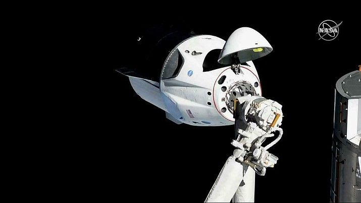 """Officials say SpaceX's new capsule for astronauts suffered an """"anomaly"""" during a routine engine test firing in Florida, causing smoke to be seen for miles.  (NASA photo)"""