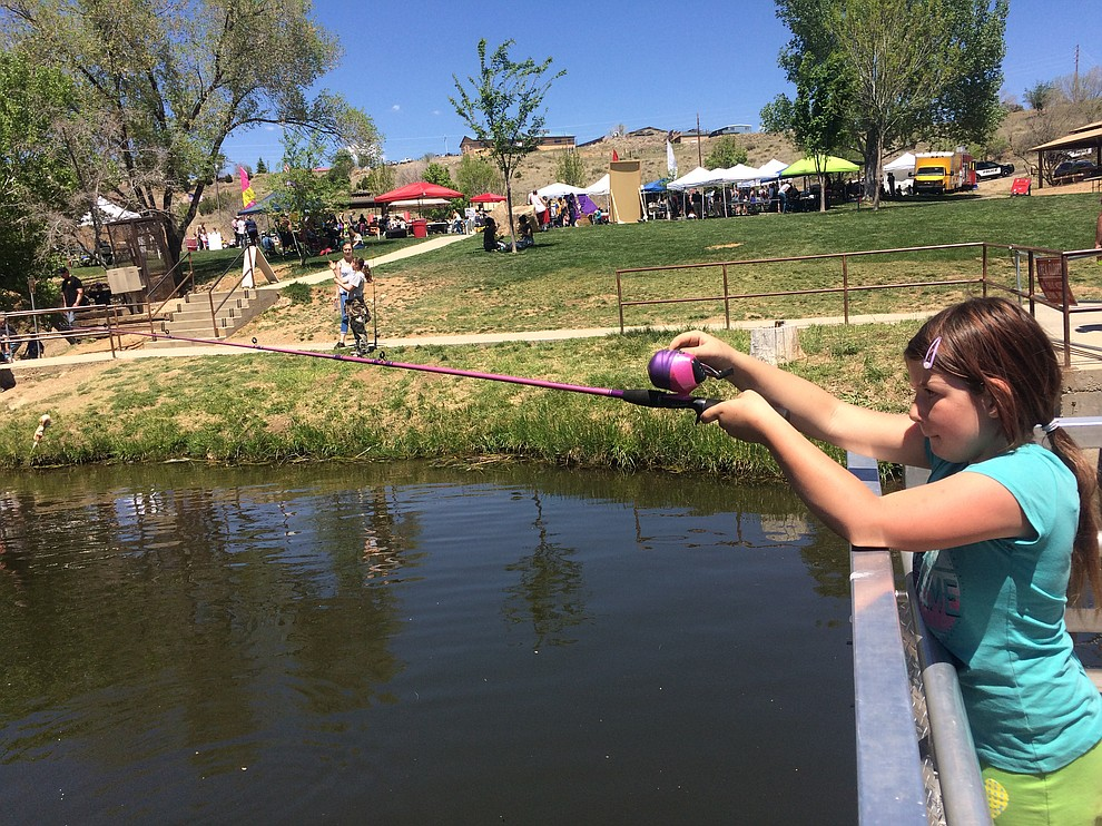 Cindy Belson fishes at Fain Park during Badges & Bobbers Saturday, April 27. (Jason Wheeler/Courier)