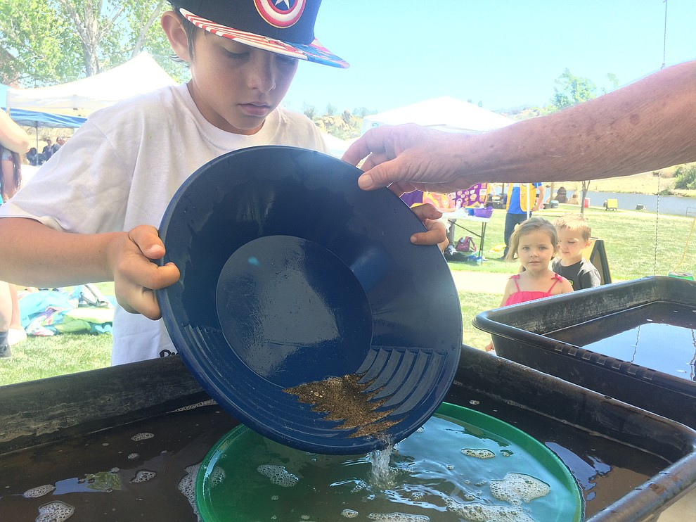 Lincoln Palguta pans for gold during Gold Fever Day at Fain Park Saturday, April 27. (Jason Wheeler/Courier)