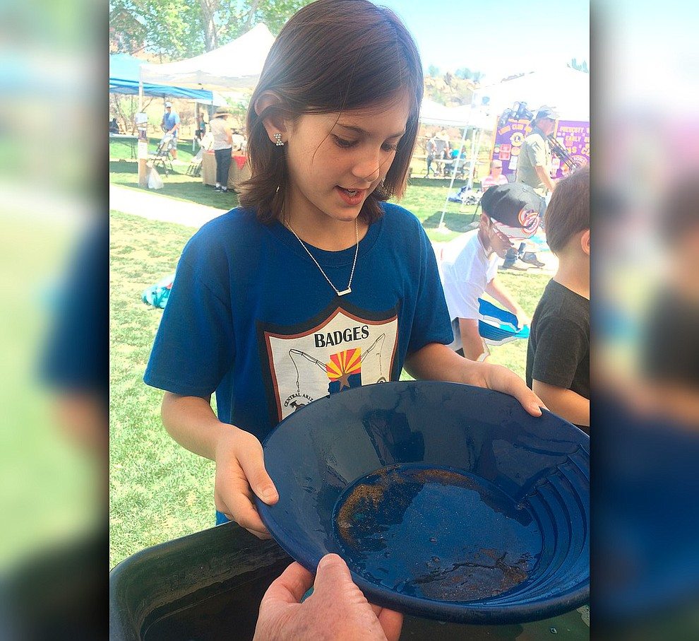 Zoey Beneda pans for gold during Gold Fever Day at Fain Park Saturday, April 27. (Jason Wheeler/Courier)