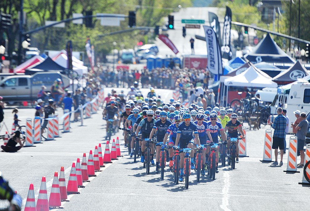 The mens field heads up Goodwin Street during the Whiskey Off Road Pro 50-mile cross country mountain bike race in Prescott Sunday, April 28.  (Les Stukenberg/Courier)