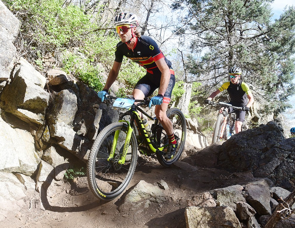 Construction Zone's Ryan Petry during the Whiskey Off Road Pro 50-mile cross country mountain bike race in Prescott Sunday, April 28.  (Les Stukenberg/Courier)