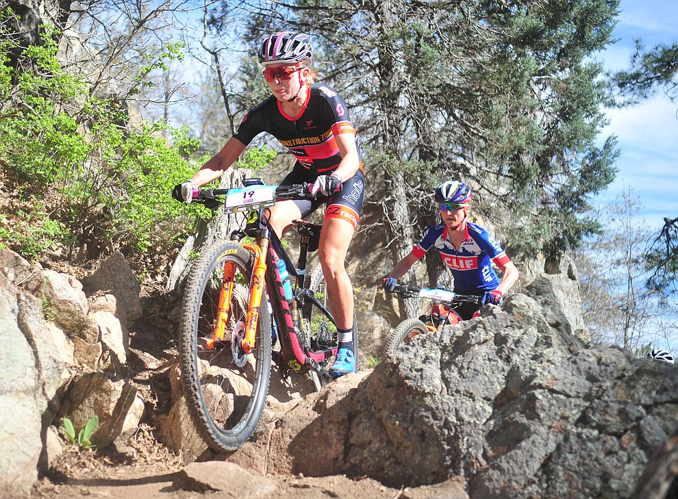 Construction Zone's Erin Huck during the Whiskey Off Road Pro 50-mile cross country mountain bike race in Prescott Sunday, April 28.  (Les Stukenberg/Courier)
