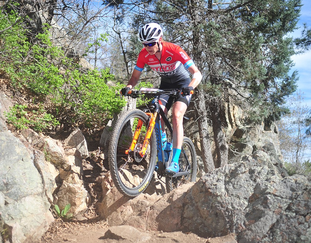 Stans-Pivot's Rose Grant during the Whiskey Off Road Pro 50-mile cross country mountain bike race in Prescott Sunday, April 28.  (Les Stukenberg/Courier)