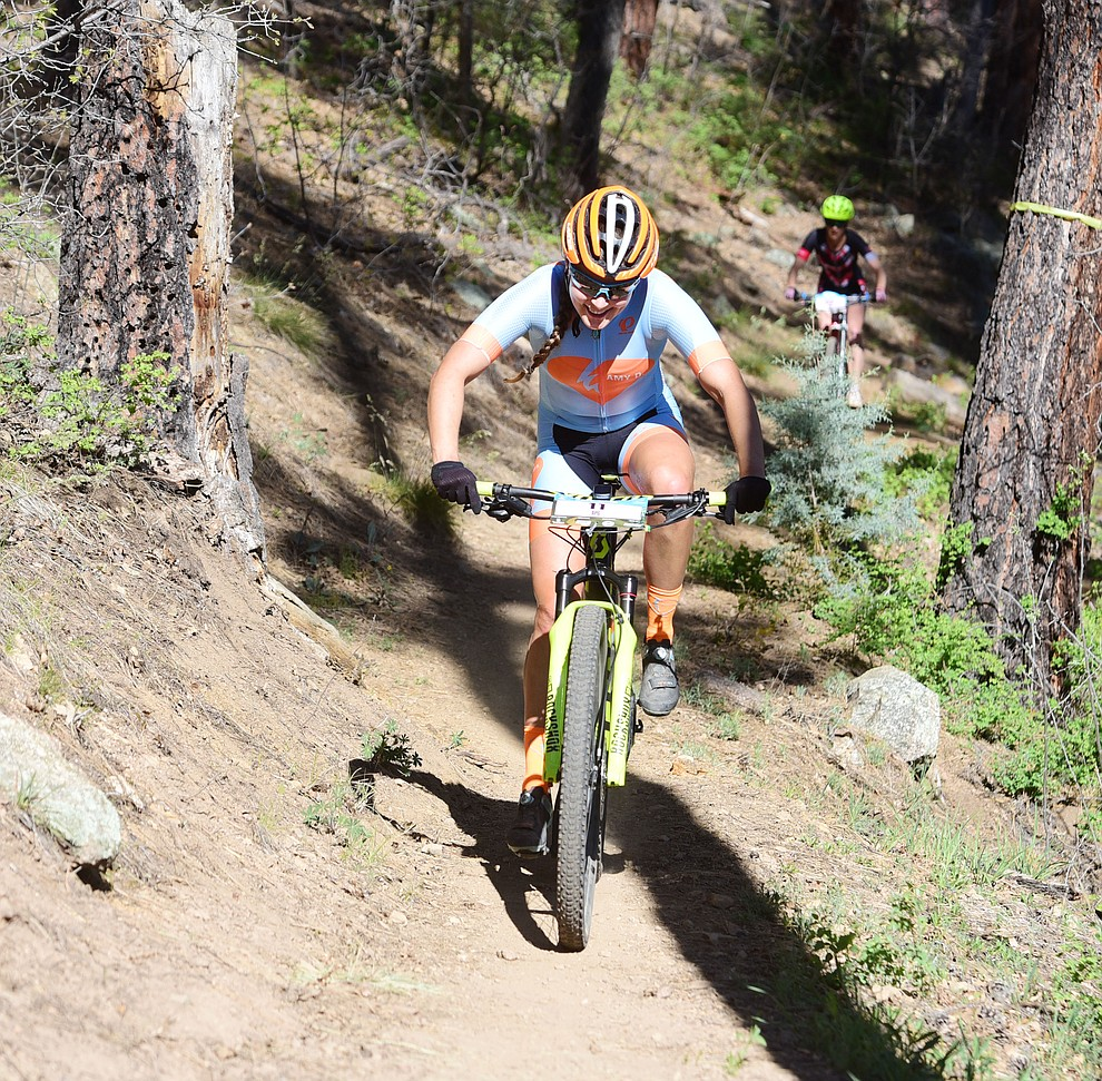 Amy D Foundation's Ashley Carelock during the Whiskey Off Road Pro 50-mile cross country mountain bike race in Prescott Sunday, April 28.  (Les Stukenberg/Courier)