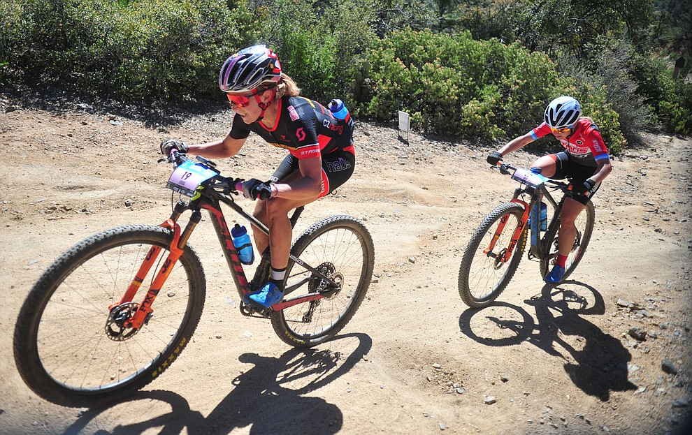 Erin Huck and Chloe Woodruff during the Whiskey Off Road Pro 50-mile cross country mountain bike race in Prescott Sunday, April 28.  (Les Stukenberg/Courier)