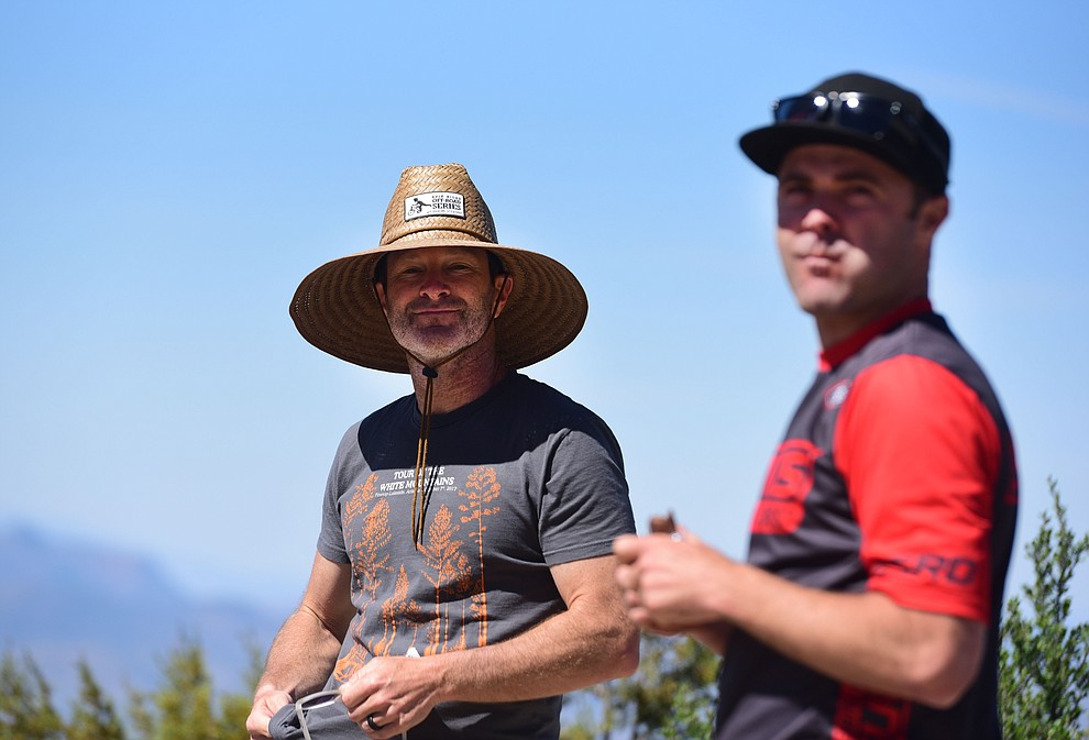 Todd Sadow and Travis Woodruff watch the action at the top of Sierra Prieta during the Whiskey Off Road Pro 50-mile cross country mountain bike race in Prescott Sunday, April 28.  (Les Stukenberg/Courier)