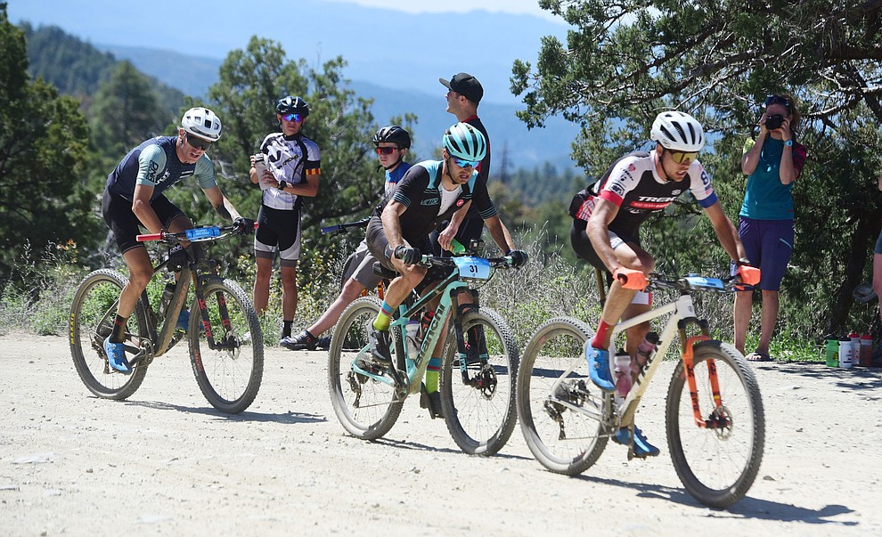 Nic Beechan, Alexy Vermeulen and Taylor Lideen during the Whiskey Off Road Pro 50-mile cross country mountain bike race in Prescott Sunday, April 28.  (Les Stukenberg/Courier)