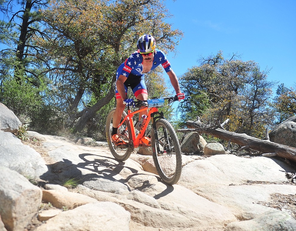 Orane Seal's Payson McElveen during the Whiskey Off Road Pro 50-mile cross country mountain bike race in Prescott Sunday, April 28.  (Les Stukenberg/Courier)