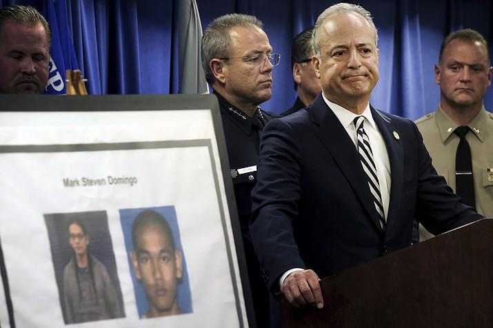 United States Attorney Nick Hanna stands next to photos of Mark Steven Domingo, during a news conference in Los Angeles on Monday, April 29, 2019. A terror plot by Domingo, an Army veteran who converted to Islam and planned to bomb a white supremacist rally in Southern California as retribution for the New Zealand mosque attacks was thwarted, federal prosecutors said Monday. (Richard Vogel/AP)