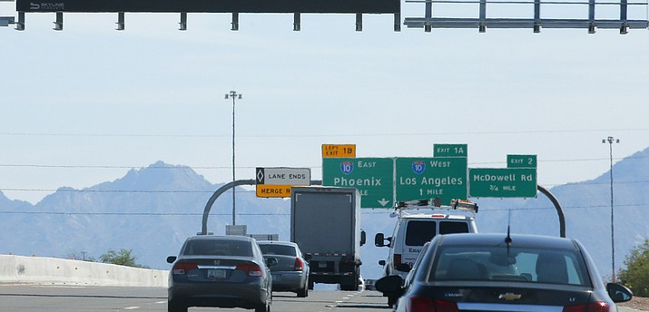 In this Sept. 11, 2015 file photo, motorists drive in Phoenix. A proposed highway that would start at the border with Mexico and serve as the southern leg of Arizona's Interstate 11 is being called both an economic benefit and an environmental threat. (Ross D. Franklin/AP, file)