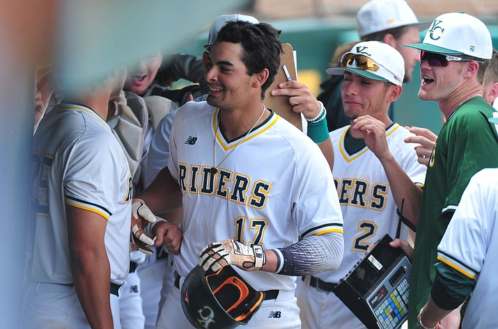 Christian Encarnacion-Strand gets congratulated in the dugout after hitting a solo homer March 26 in Prescott. Encarnacion-Strand was named the 2019 ACCAC Player of the Year on Monday, April 29, 2019. He is the ninth Yavapai College baseball player to win the award in program history. (Les Stukenberg/Courier, file)